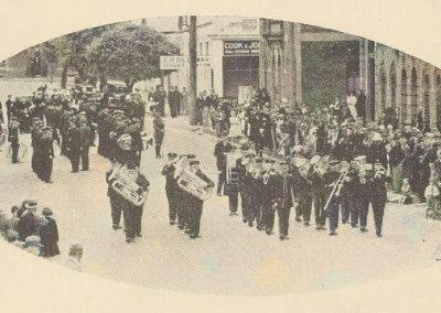 1935 The Hobart Municipal Band leading a processionof five bands through the streets of Burnie to West Park